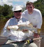 Rick with one of the many nice snook they caught in 2 days fishing. Snook Fishing Photo Gallery - Islamorada Fishing Charters
