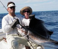 Sailfish Fishing Gallery: Her first sailfish and numerous kingfish and cero mackerel caught on her first day offshore. Islamorada Fishing Charters Florida Keys