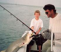 Shark Fishing Gallery: LOOK at those JAWS! Serious BAGGING RIGHTS for kids at school, and great photos too. Islamorada Fishing Charters Florida Keys